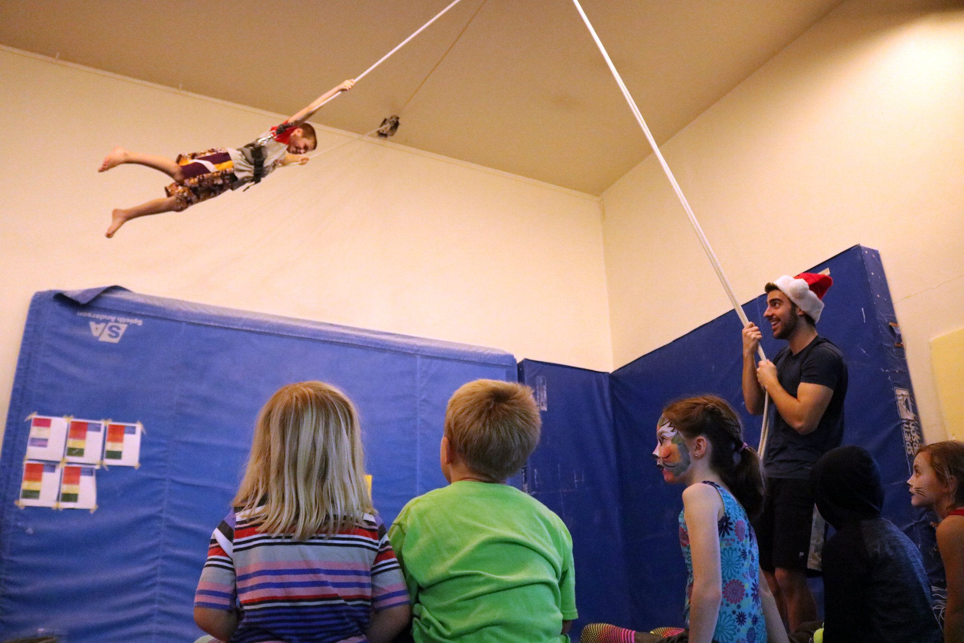 Reindeer Flight School in the spotting harness at Iron Rail Gymnastics